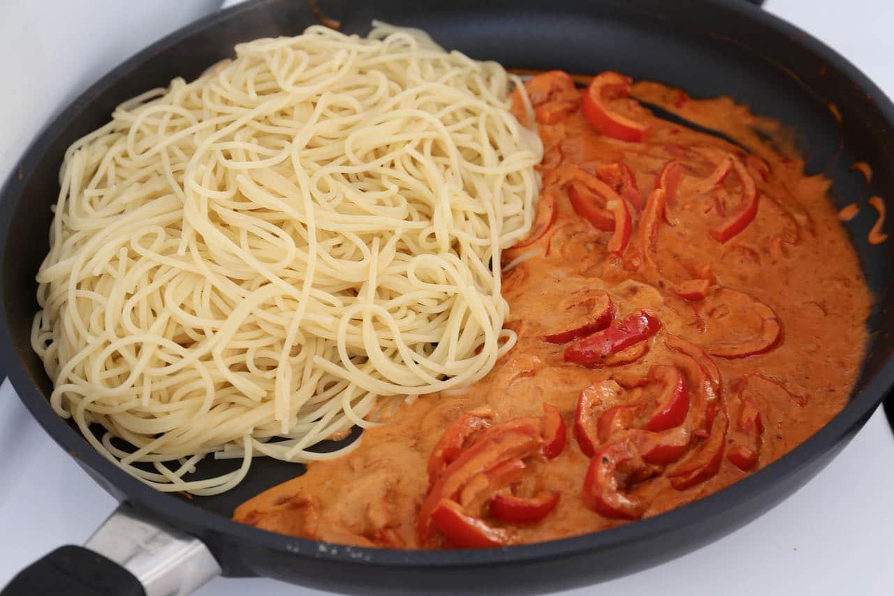 Toss al dente spaghetti with spicy vegetarian harissa pasta sauce.