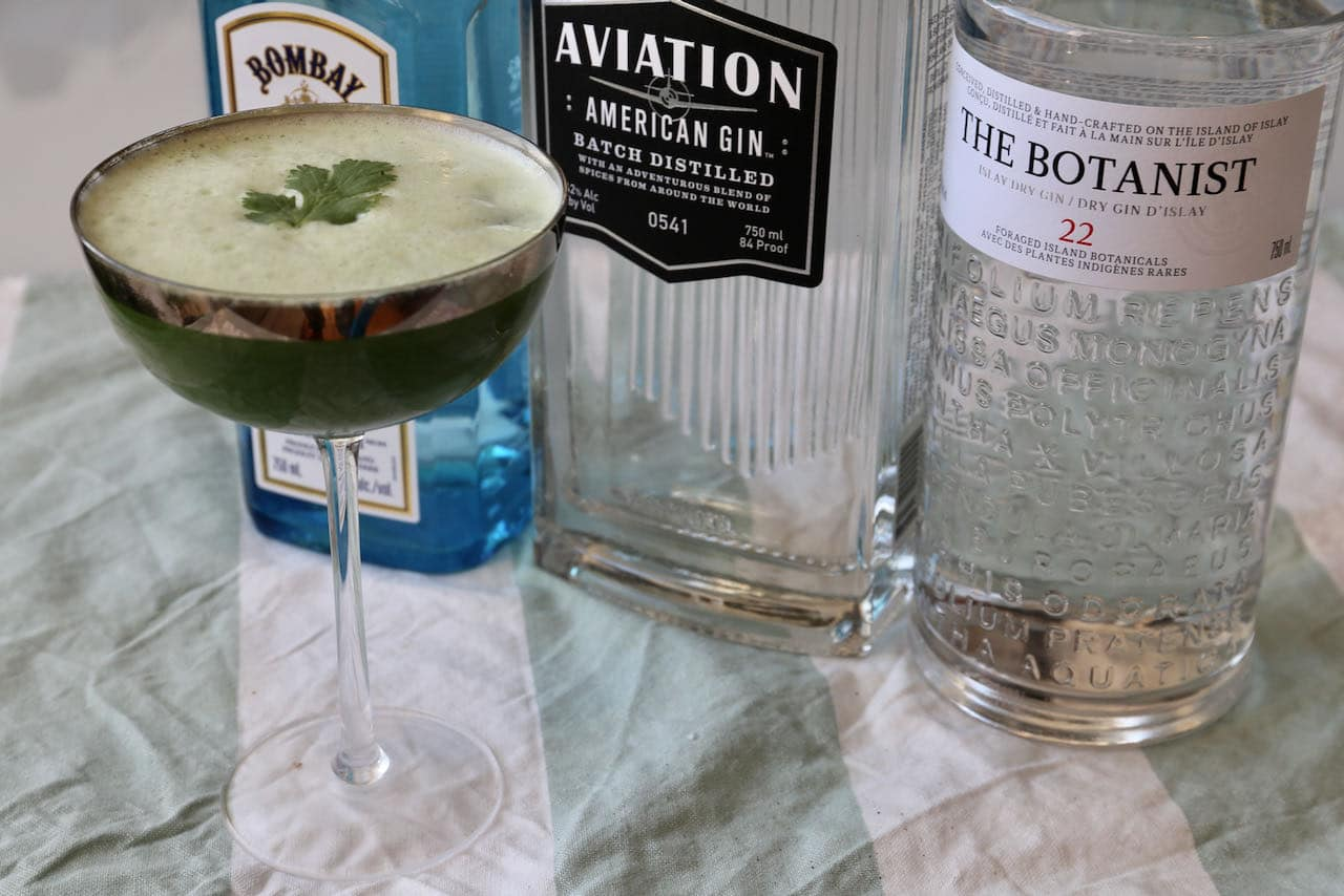 Let the egg white foam float to the top of the glass before garnishing with a fresh cilantro.