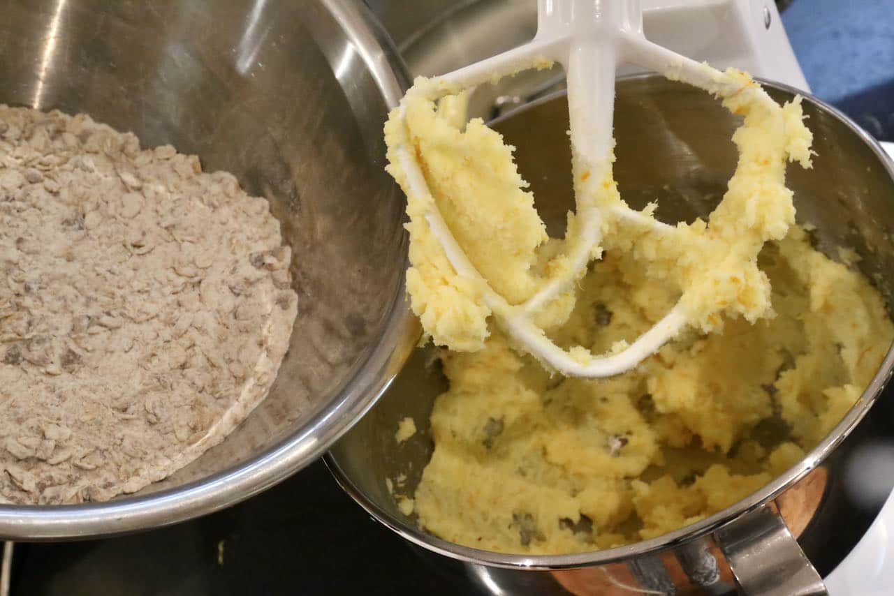 Use a stand mixer to cream butter with orange zest then add dry ingredients.