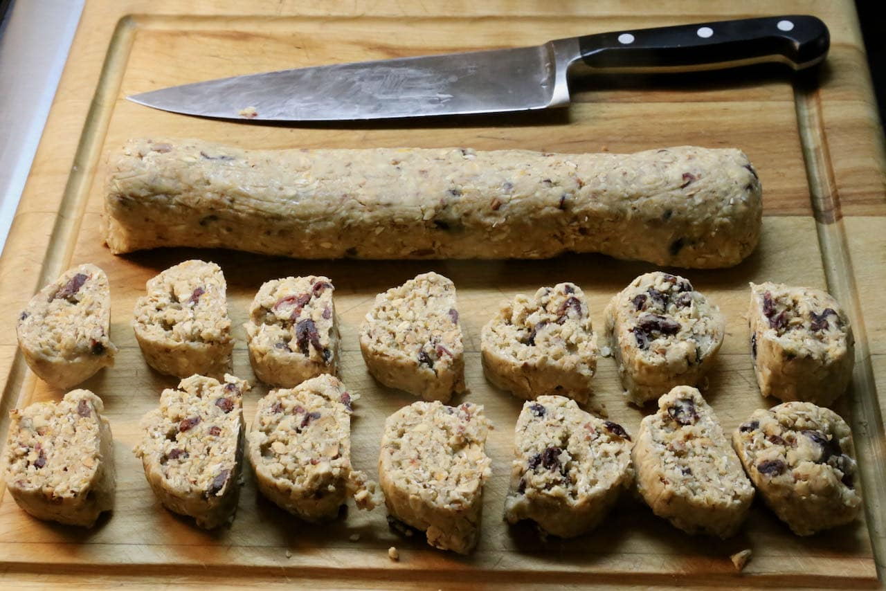 Use a sharp knife to slice Healthy Oatmeal Cranberry Cookie dough.