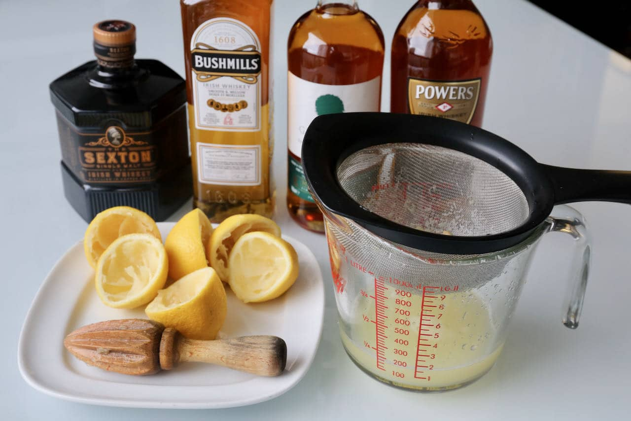 Pass freshly squeezed lemon juice through a sieve to make the best Irish Whiskey Sour cocktail.