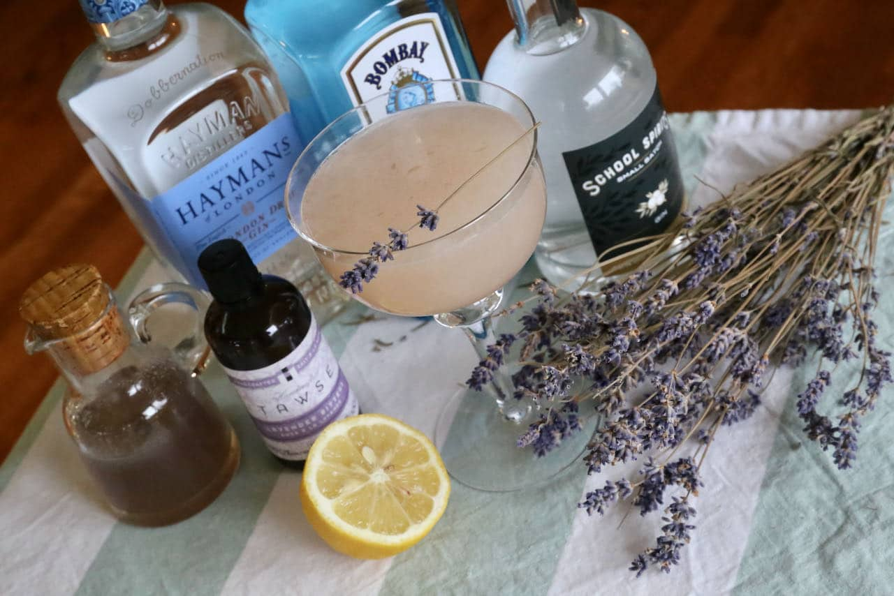 This homemade Lavender Gin Cocktail recipe is garnished with a lavender sprig.