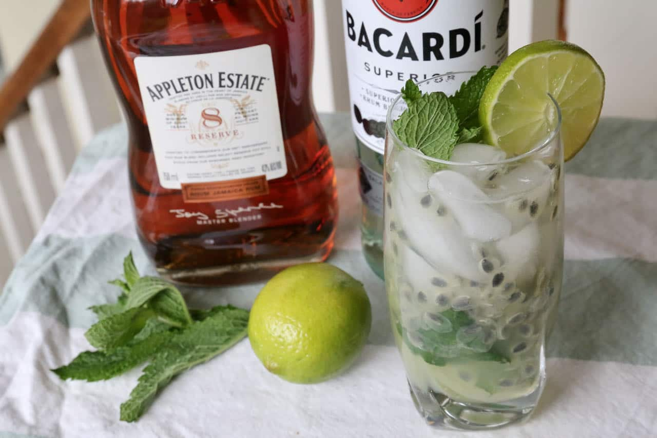 This easy Passion Fruit Mojito recipe is garnished with fresh mint and lime wedge.