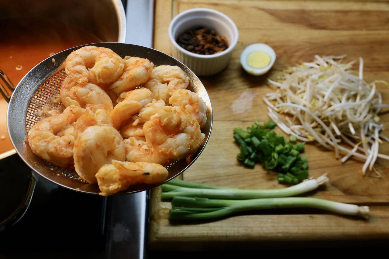 Poach prawns in soup broth then assemble recipe in soup bowls.