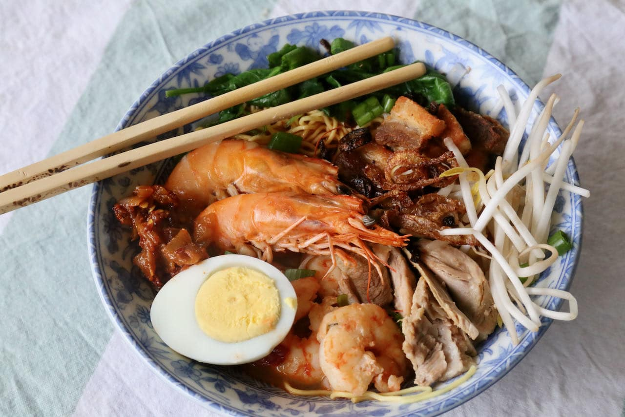 Serve our Hokkien Mee recipe with fried shallots, bean sprouts, scallions, chili paste and hard boiled eggs.