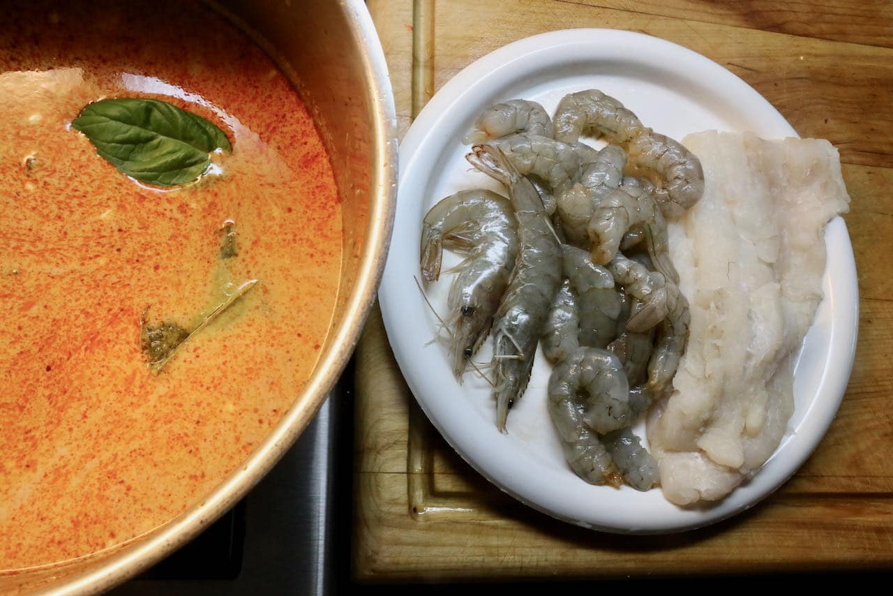 Homemade Seafood Laksa features prawns and white fish.