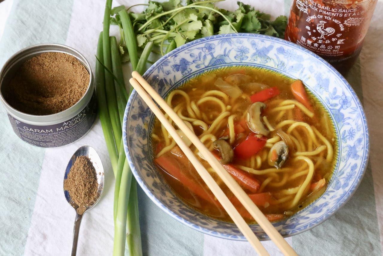Garnish this healthy Veg Thukpa recipe with garam masala, scallions, cilantro and chili paste.