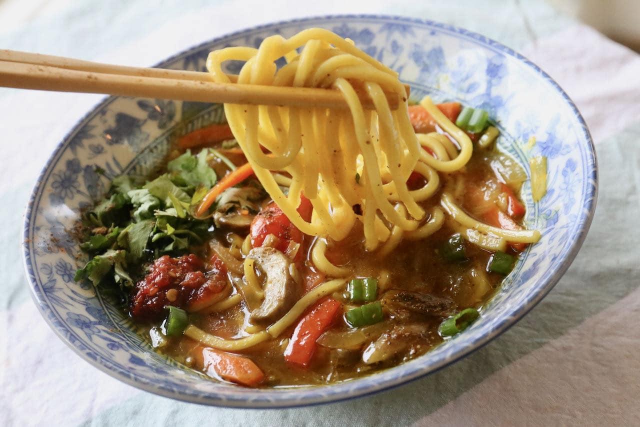 Serve Veg Thukpa with chopsticks and a spoon.