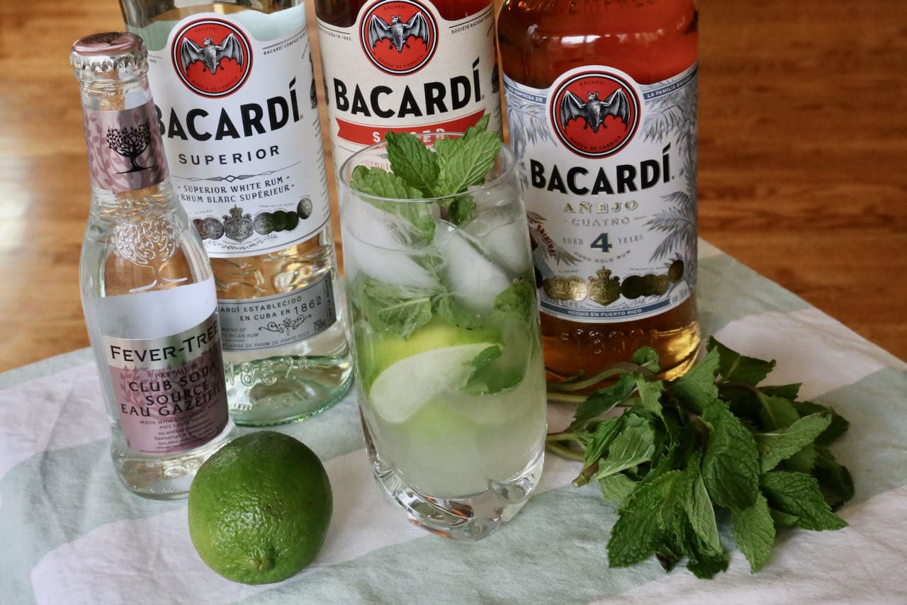 Our easy Bacardi Mojito cocktail is garnished with fresh mint and lime wedge.