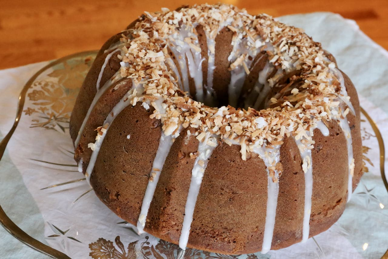 Drizzle glaze over the Banana Bread Bundt and sprinkle with toasted coconut.