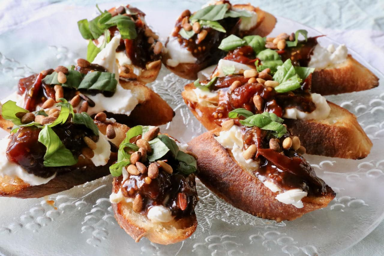 Burrata Bruschetta are a popular Italian finger food or appetizer to serve to a crowd.
