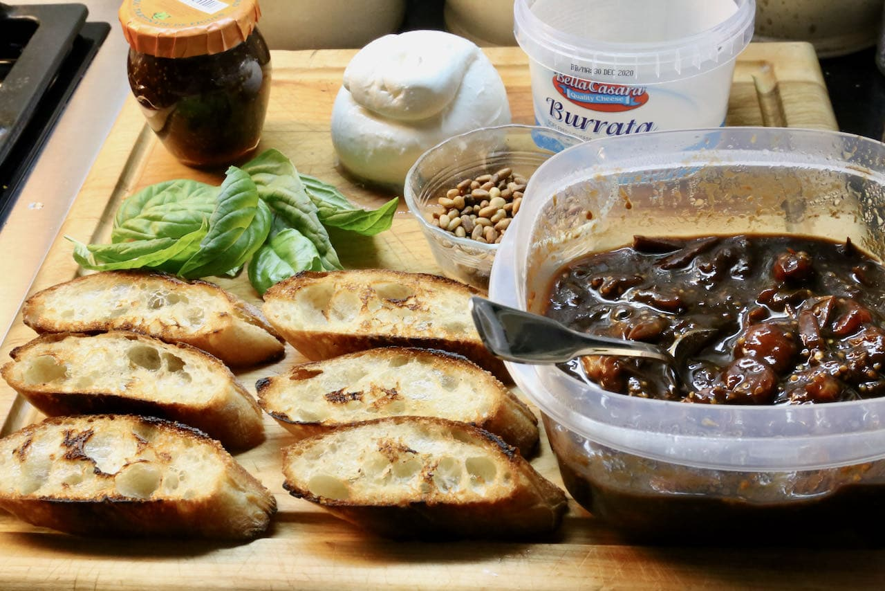 Burrata Bruschetta Crostini assembly.