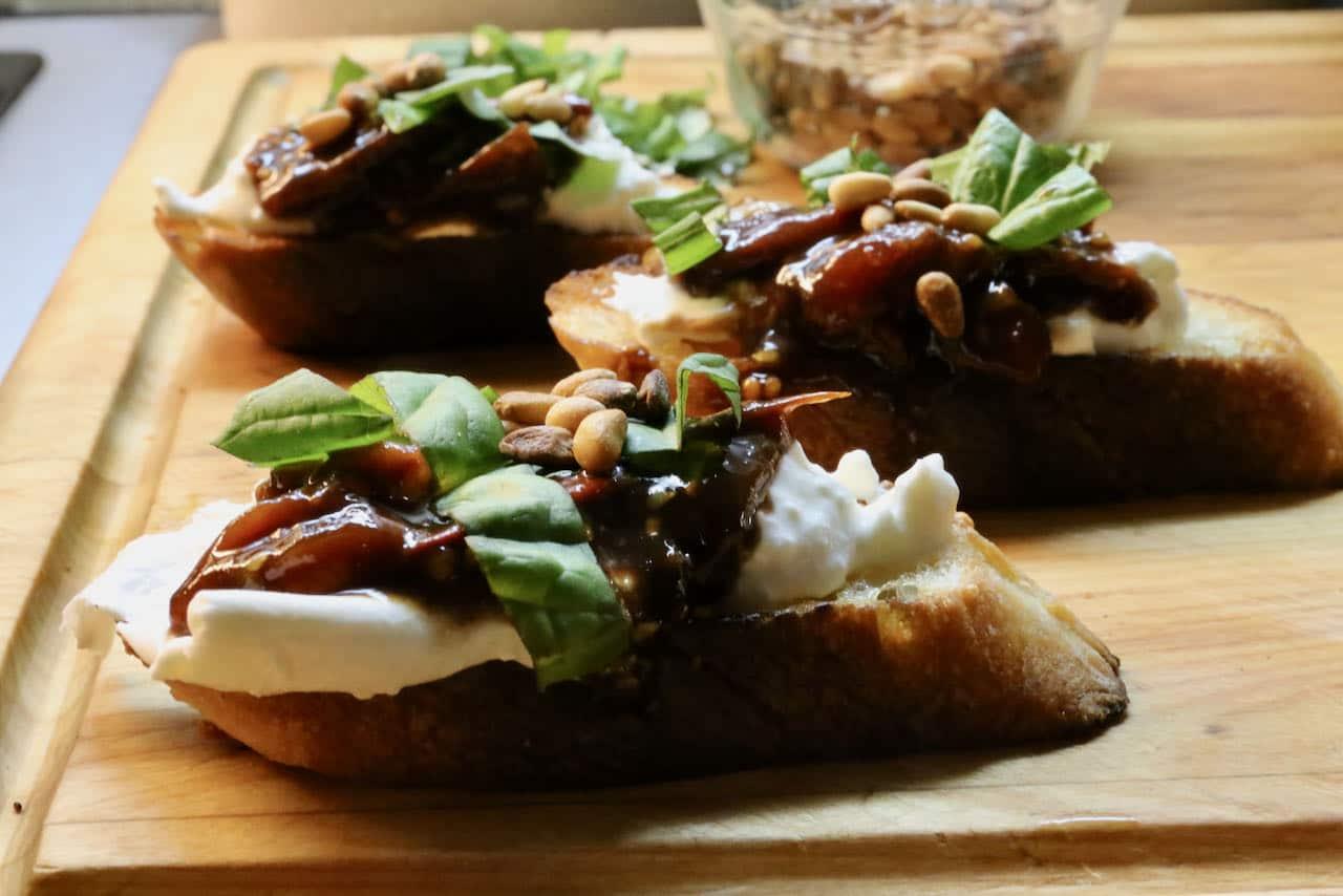 Our easy Burrata Bruschetta features creamy mozzarella cheese, tomato chutney, basil and pine nuts.