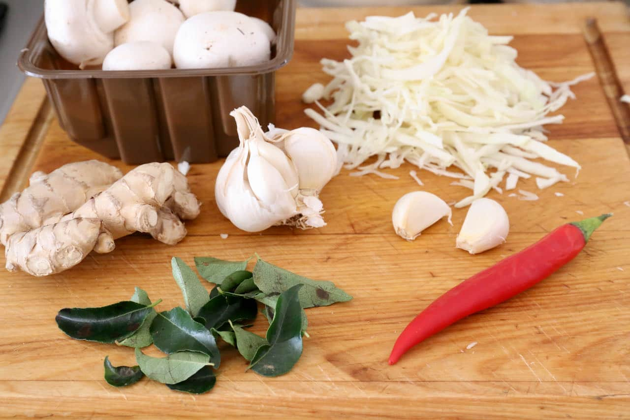 Our homemade healthy Paneer Soup features garlic, cabbage, mushrooms, ginger, curry leaf and chili.