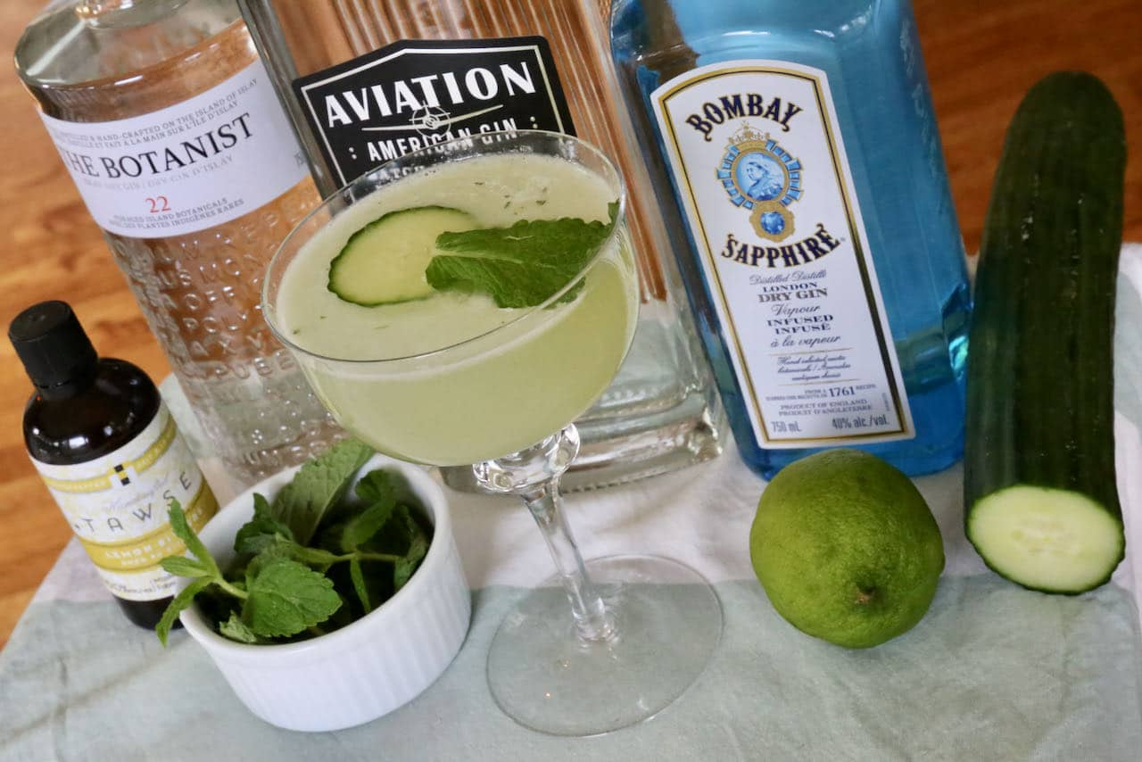 Garnish the cocktail with a slice of cucumber and fresh mint leaf.