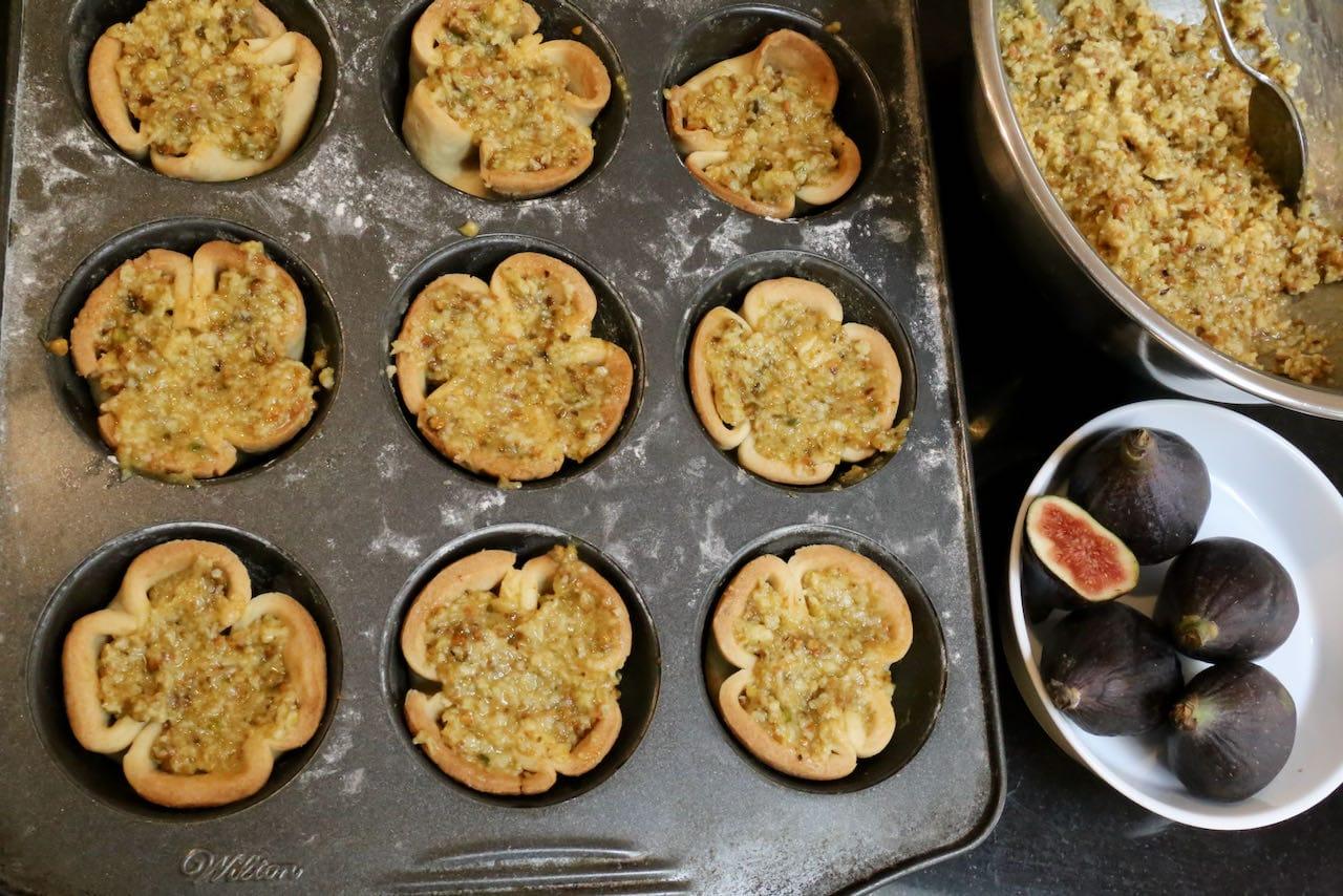 Fill par baked tartlets with pistachio frangipane.