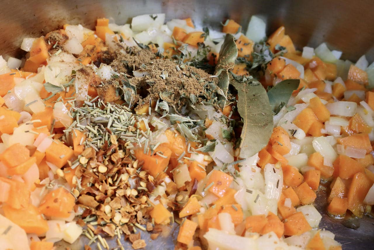 Saute vegetables in oil then add spices in a large pot.