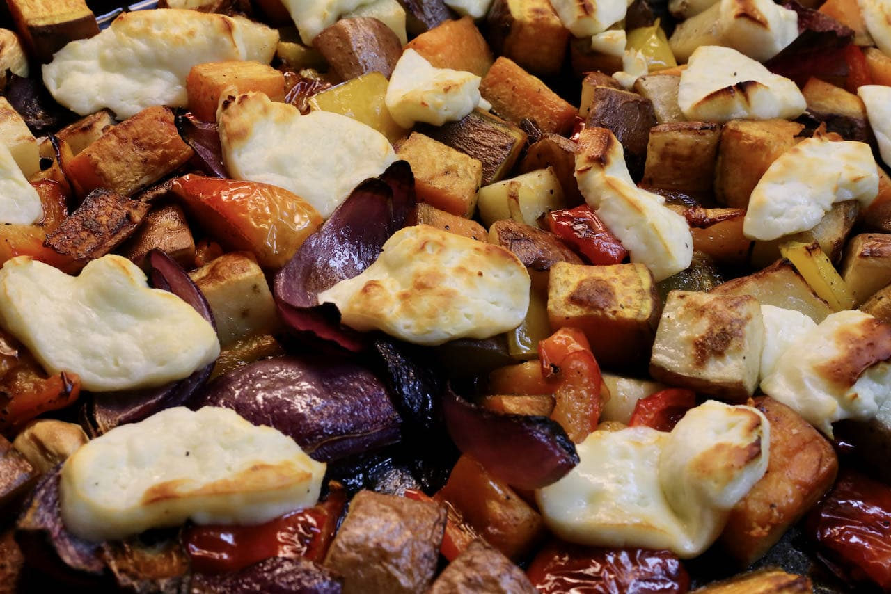 Oven Baked Halloumi is finished cooking one the cheese has browned and the roasted vegetables are crispy.