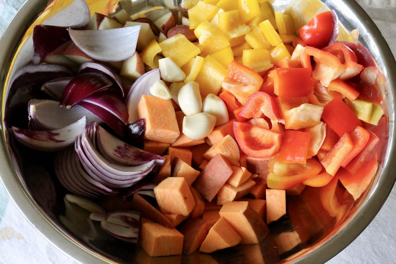 In a large bowl toss together the chopped vegetables with garlic, olive oil, salt and pepper.