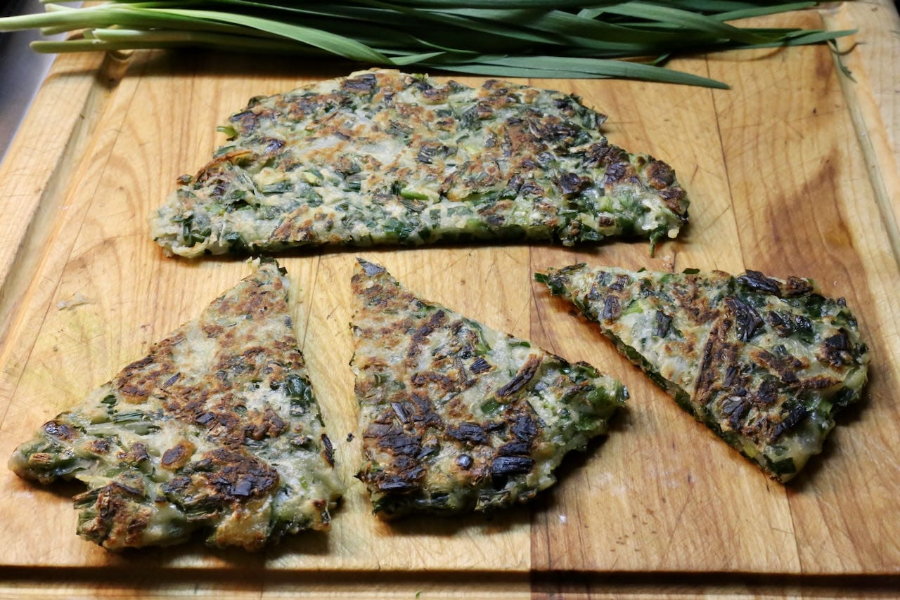 Slice each Korean Chive Pancake into triangles and serve hot.