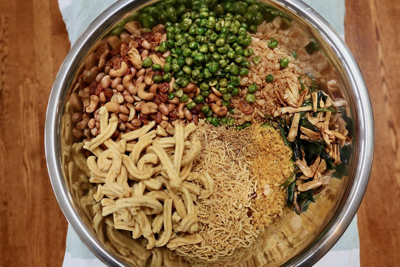 Let Chivda Chanachur Bombay Mixture Namkeen recipe ingredients cool in a large bowl before mixing.