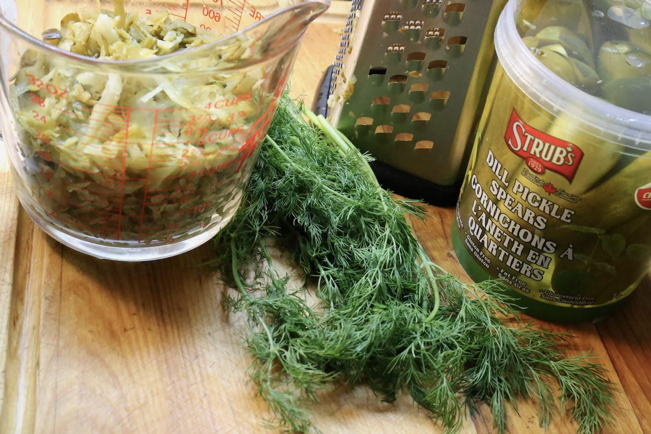 Use a cheese grater to shred dill pickles.