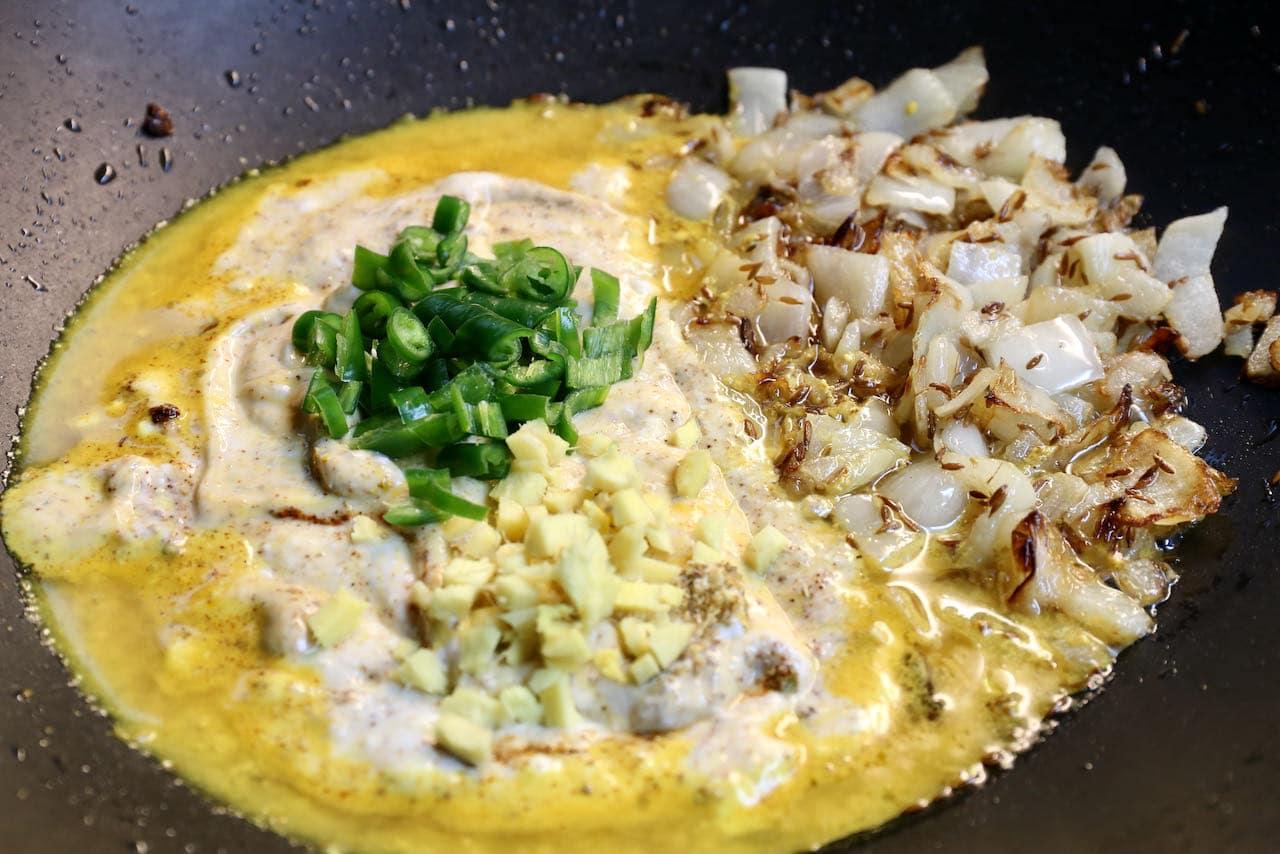 Prepare Pitod Ki Sabji sauce in a large wok or skillet.