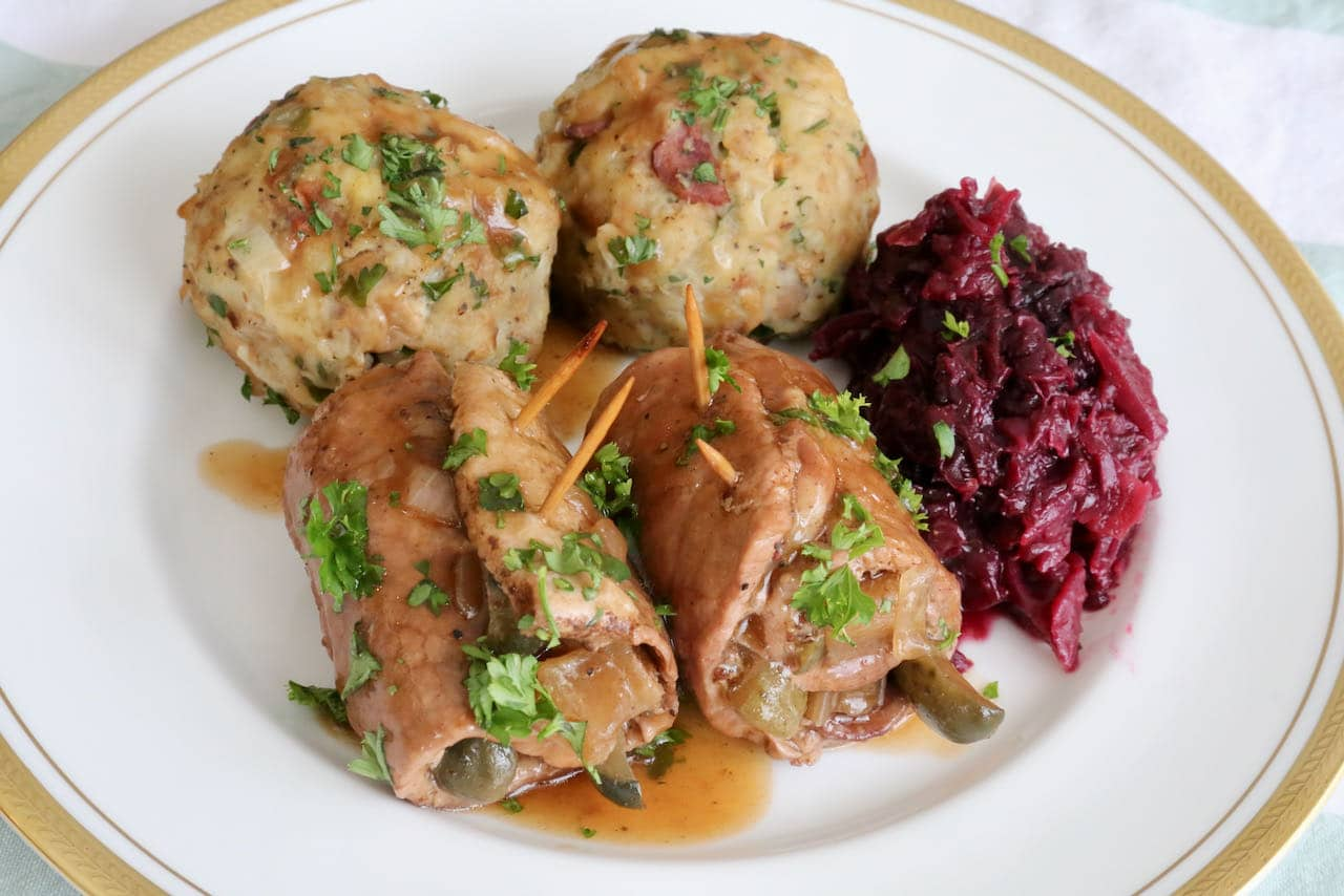 Serve Pork Rouladen with braised cabbage and German bread dumplings.