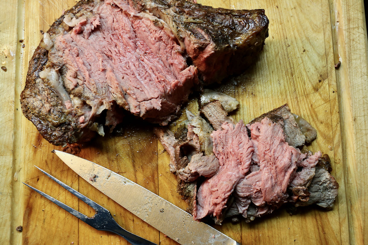 Roast the prime rib until medium rare then thinly slice.