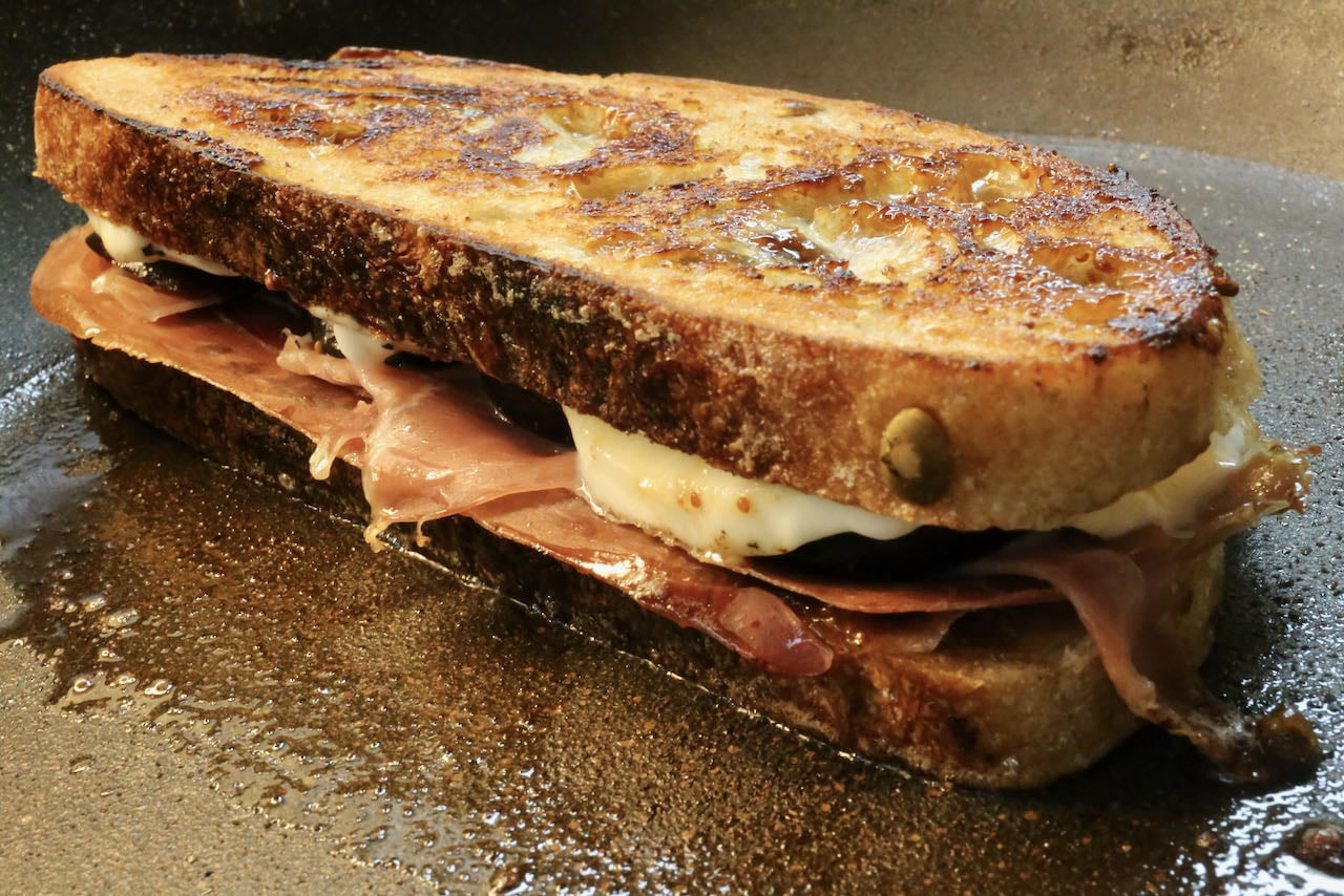 Cook the Prosciutto Grilled Cheese on a hot skillet or griddle until golden brown.