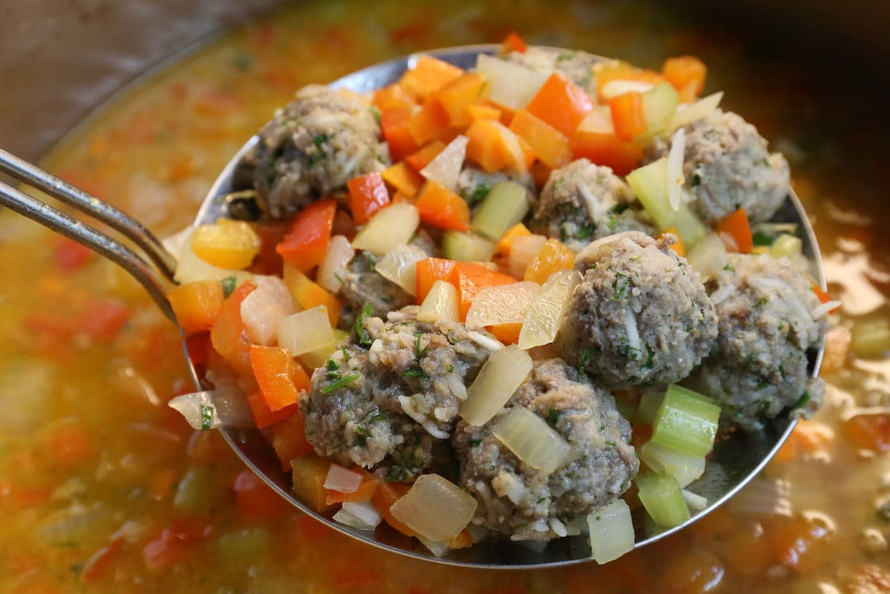 Cook Ciorba de Perisoare rice meatballs in Romanian Soup broth.