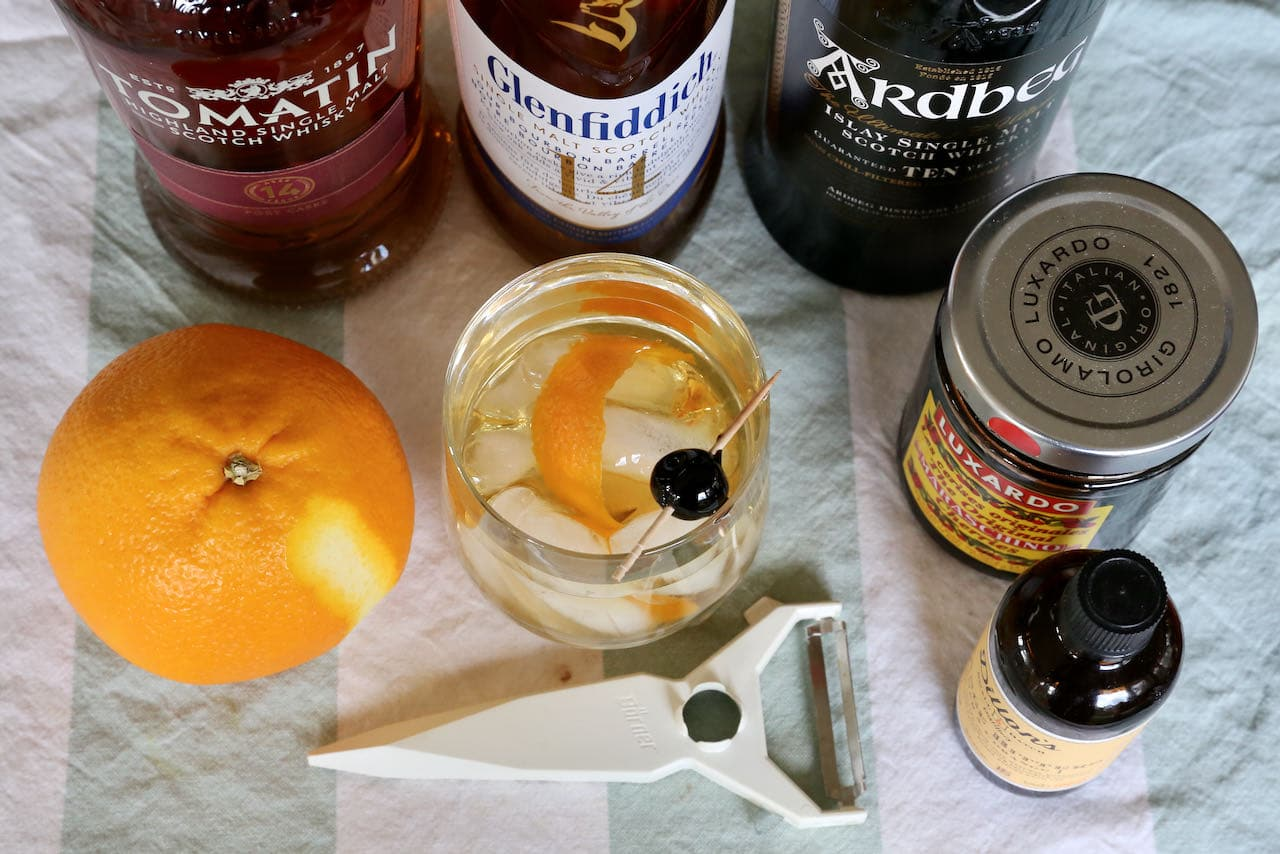 The classic Scotch Old Fashioned features bitters, white sugar, orange peel, Scottish whisky and a cherries.