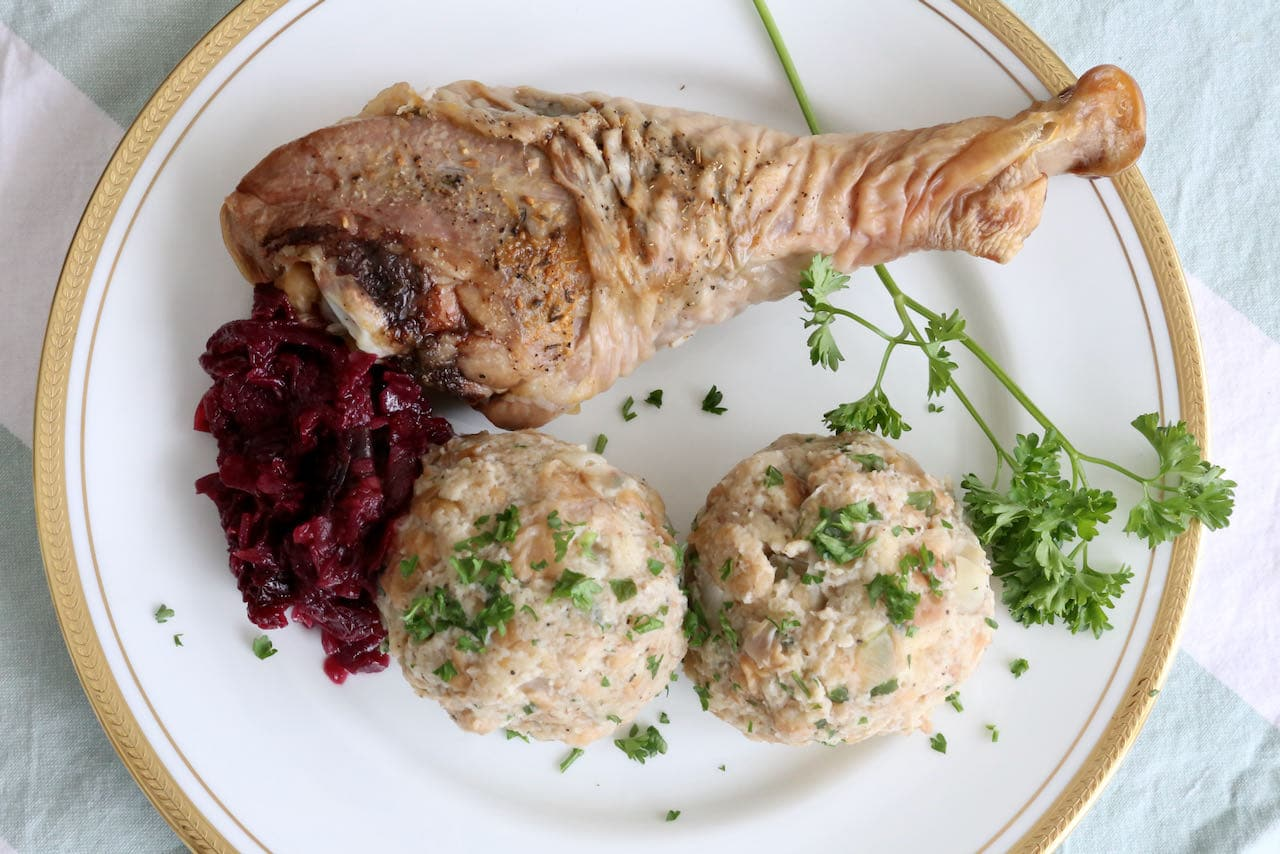 Semmelknödel is a popular German side dish served with braised cabbage and roast meat like turkey leg.