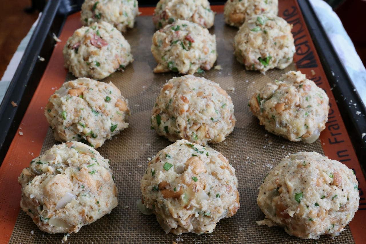 Let Speckknödel German Bread Dumplings rest on a baking sheet before boiling.