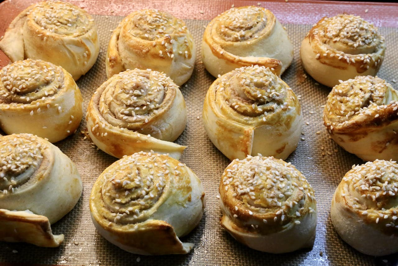 Tahini Rolls are finished baking once they are golden brown and have a crunchy exterior.