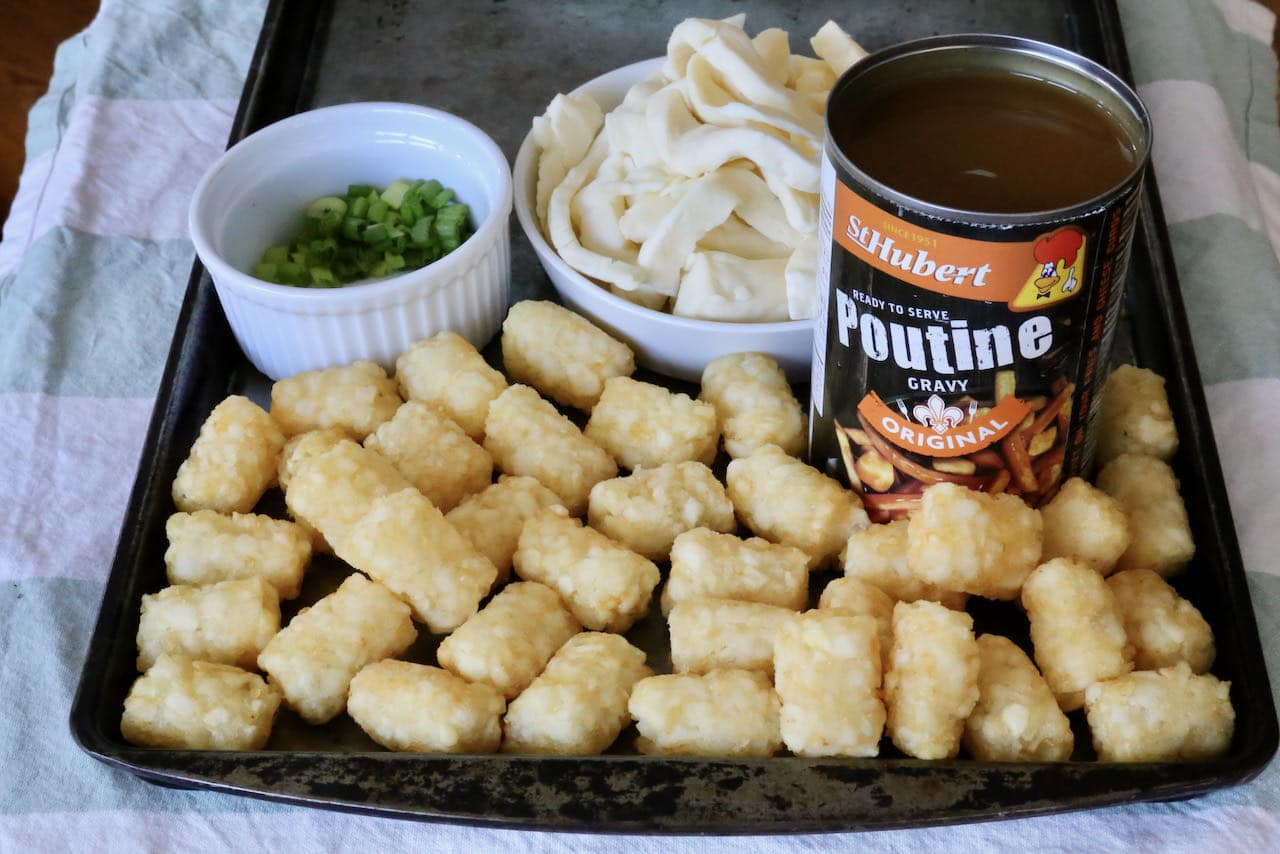 Our easy poutine features baked McCain Tater Tots, St Hubert Gravy, cheese curds and chopped green onions.