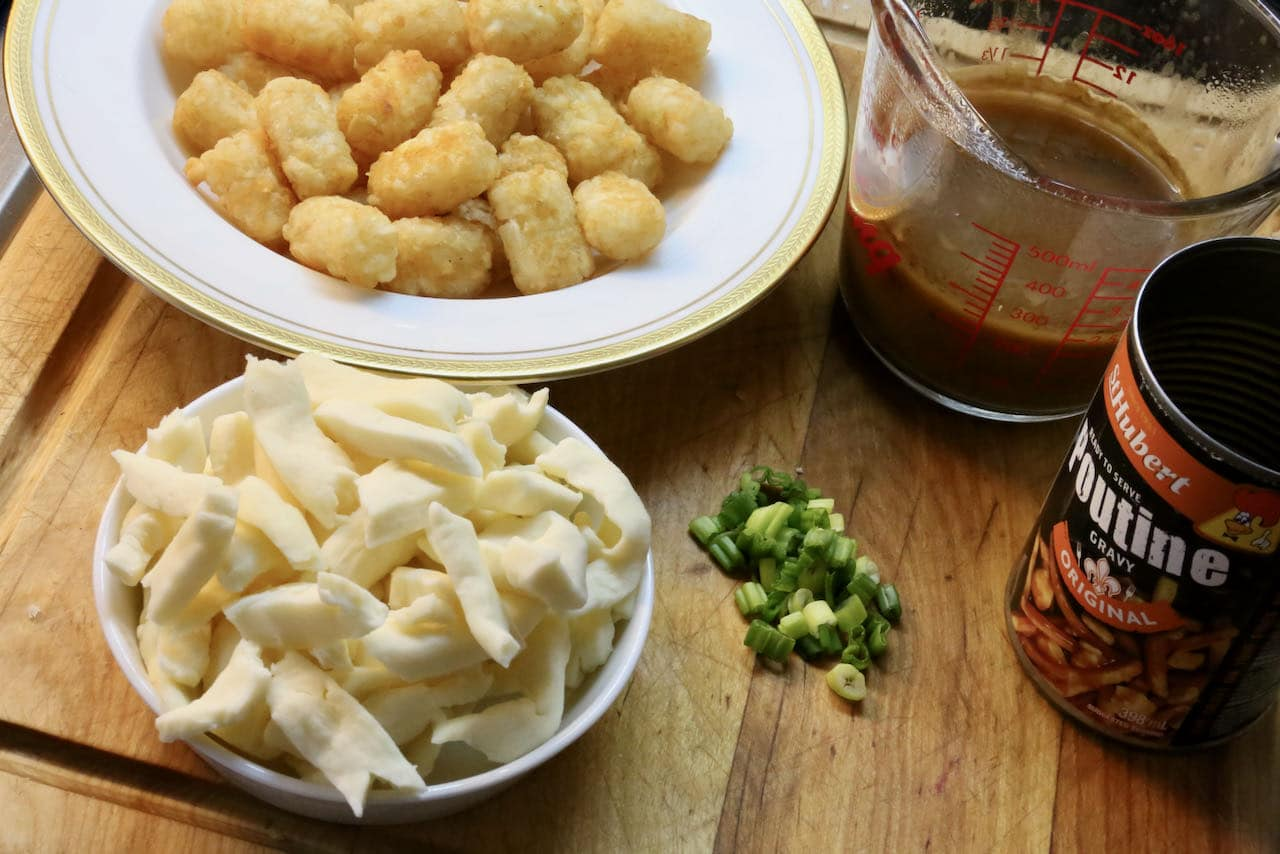 Poutine Assembly: McCain Tater Tots are topped with cheese curds, hot brown gravy and sliced scallions or chives.