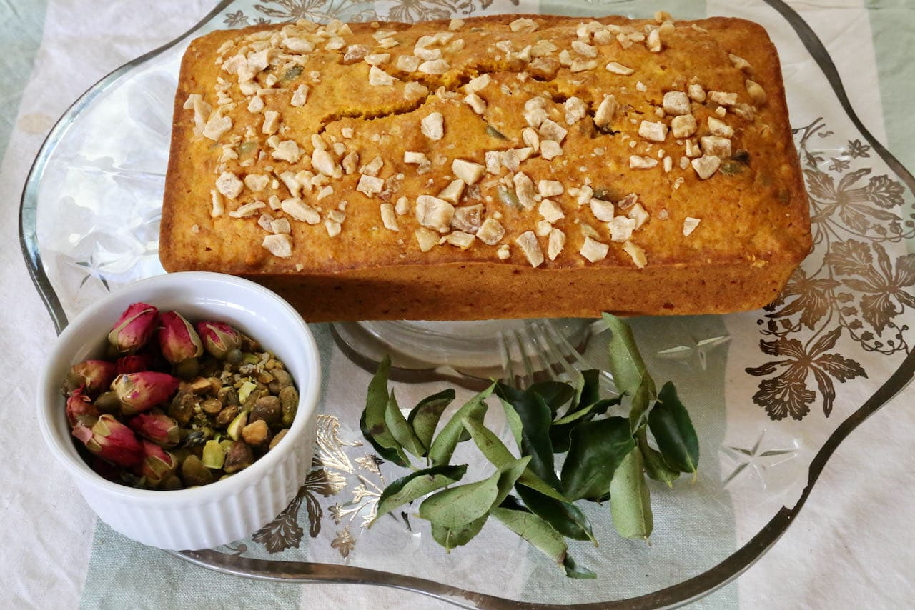 Indian Cake garnish ideas: curry leaf, dried rose buds and chopped pistachio.