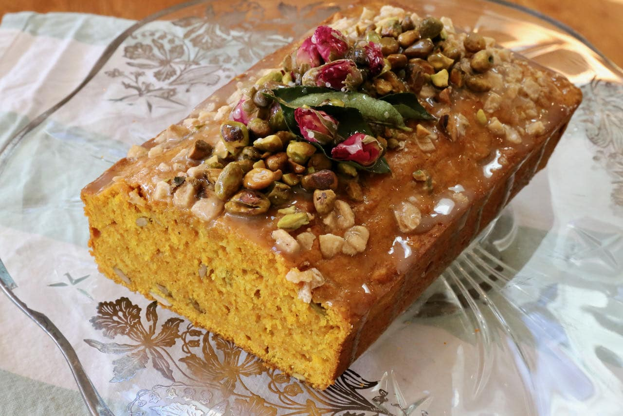 Slice open our Indian Turmeric Tea Cake and you'll find a bright yellow crumb interior dotted with pumpkin seeds.