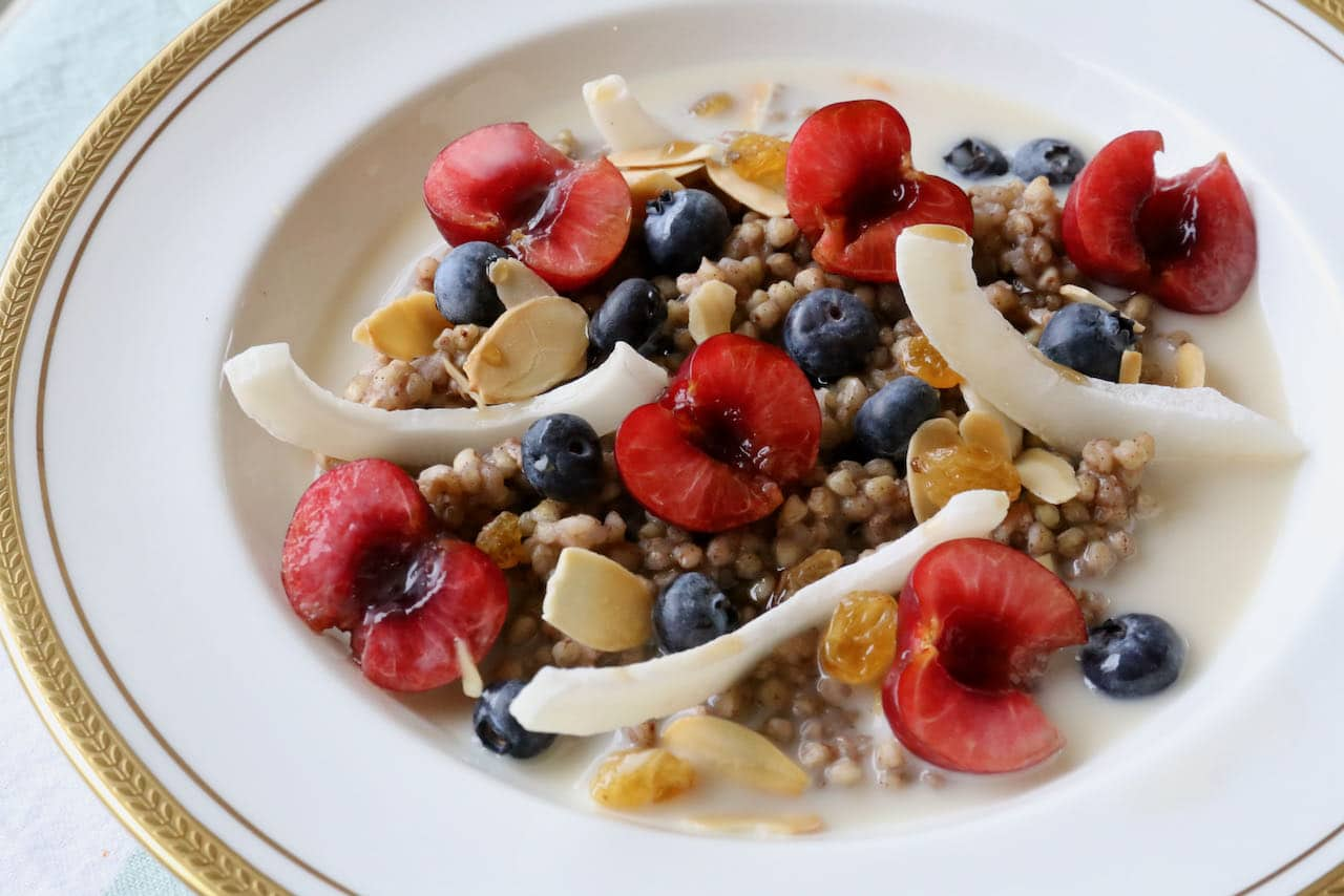 Serve gluten free porridge with berries and stone fruit in the summer.