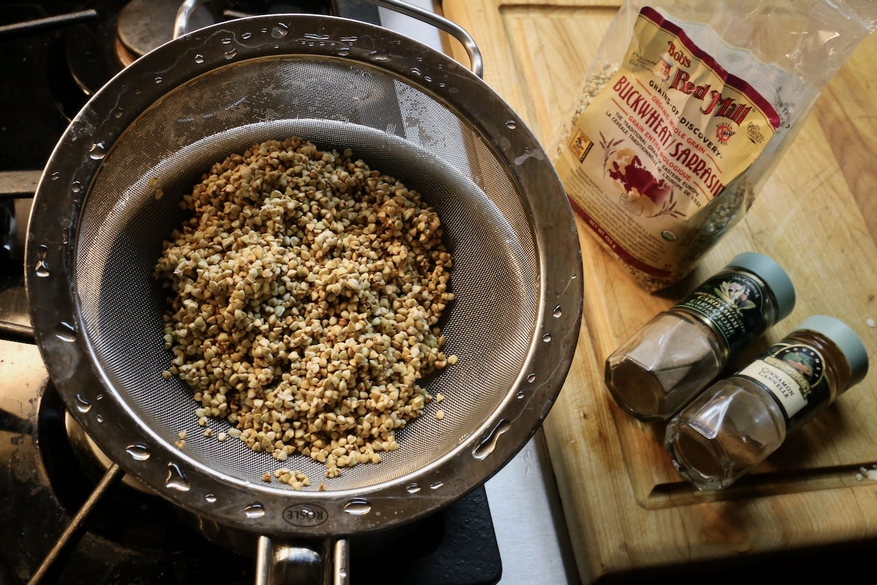Wash and strain buckwheat groats in a sieve before cooking.