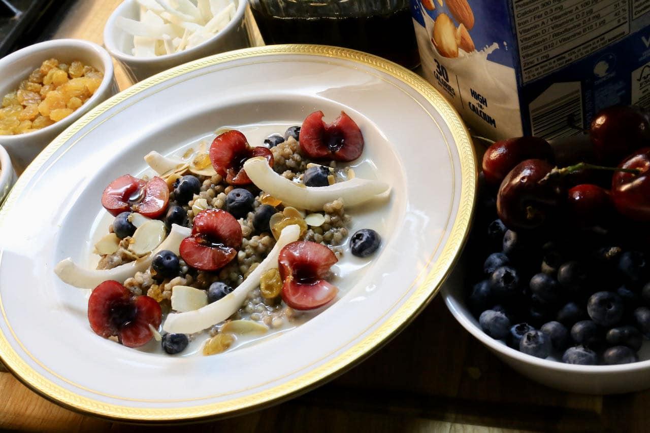 We love serving this vegan gluten free porridge with almond milk, maple syrup, berries, cherries, almonds and coconut.