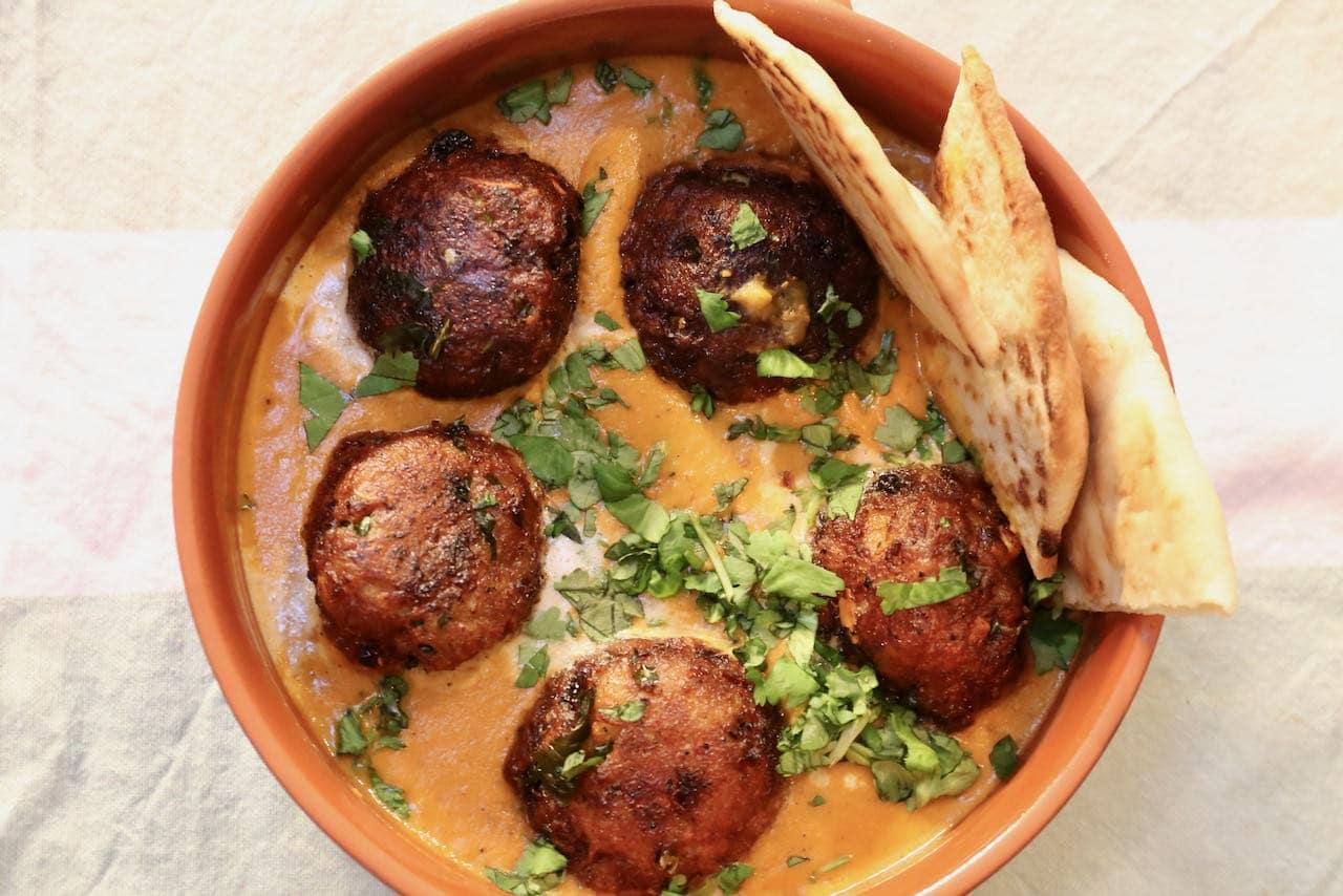 Serve homemade vegetarian Malai Kofta with grilled naan or basmati rice.