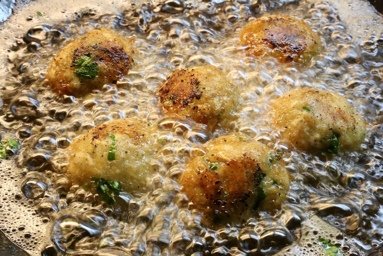 Deep fry Malai Kofta balls in vegetable oil until golden brown and crispy.