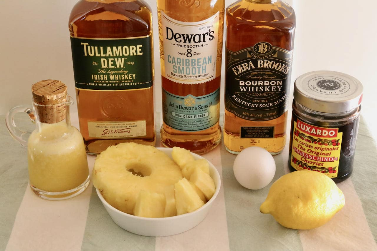 Homemade Whiskey and Pineapple Juice ingredients.