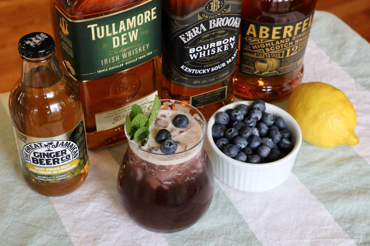 The classic Blueberry Buck cocktail features ginger beer, lemon juice, whiskey and blueberries.