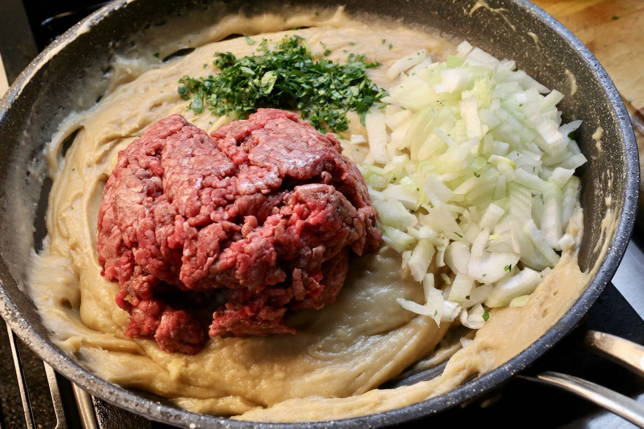 Add chopped onions, parsley and minced beef.