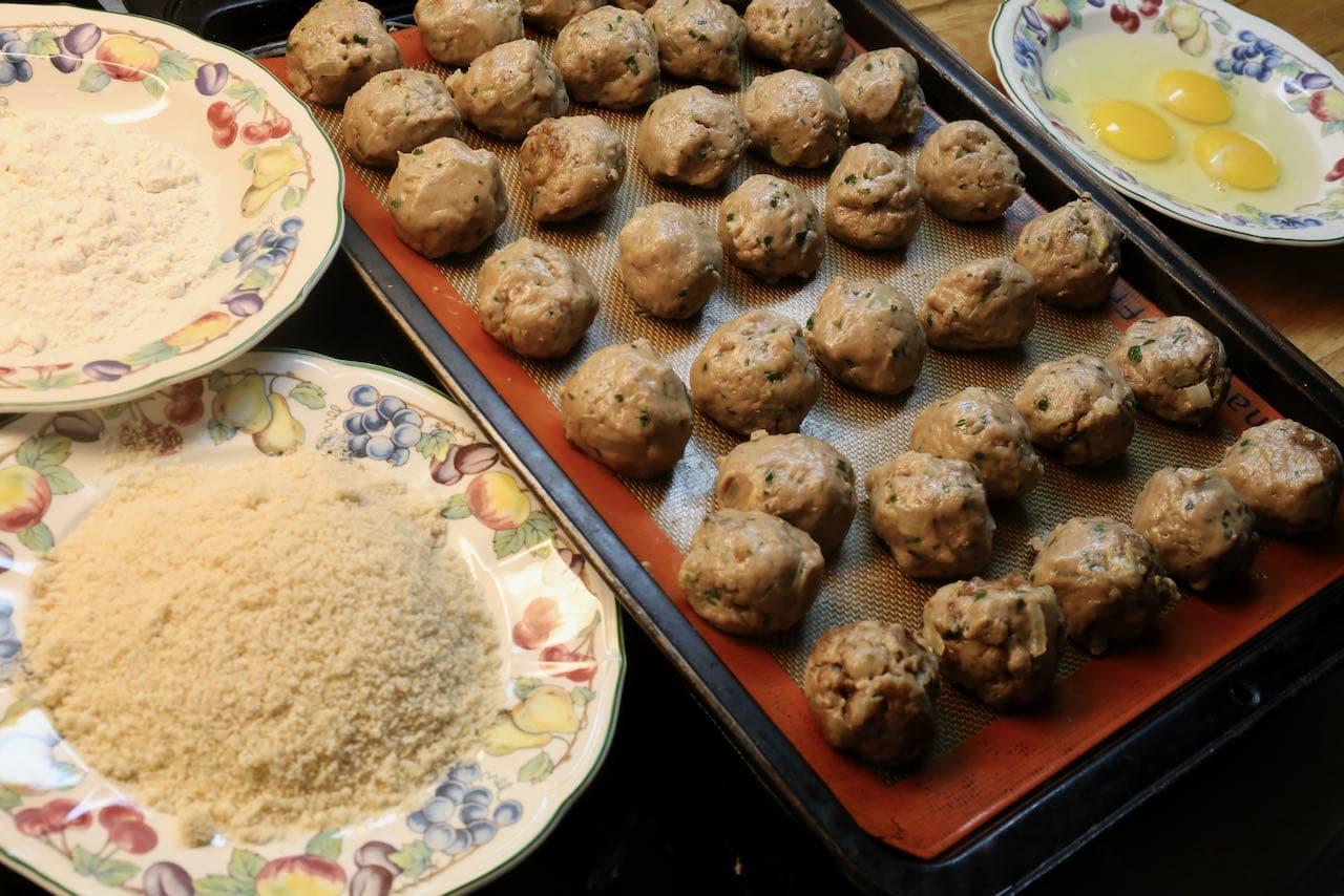 Dip bitterballen into a flour, bread crumbs and beaten eggs.