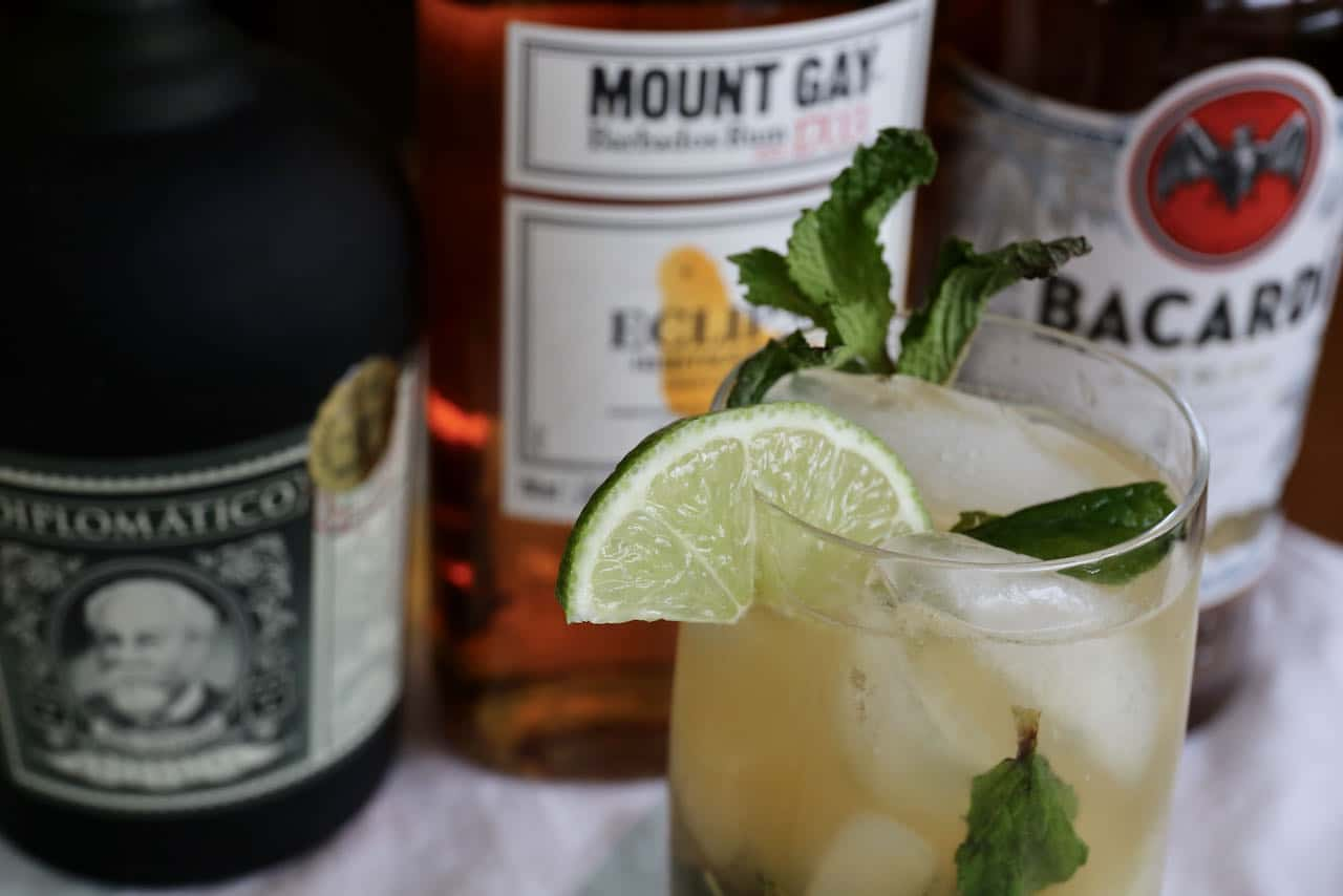Serve a Dark Rum Mojito with whole ice cubes or crushed ice in a highball or rocks glass.