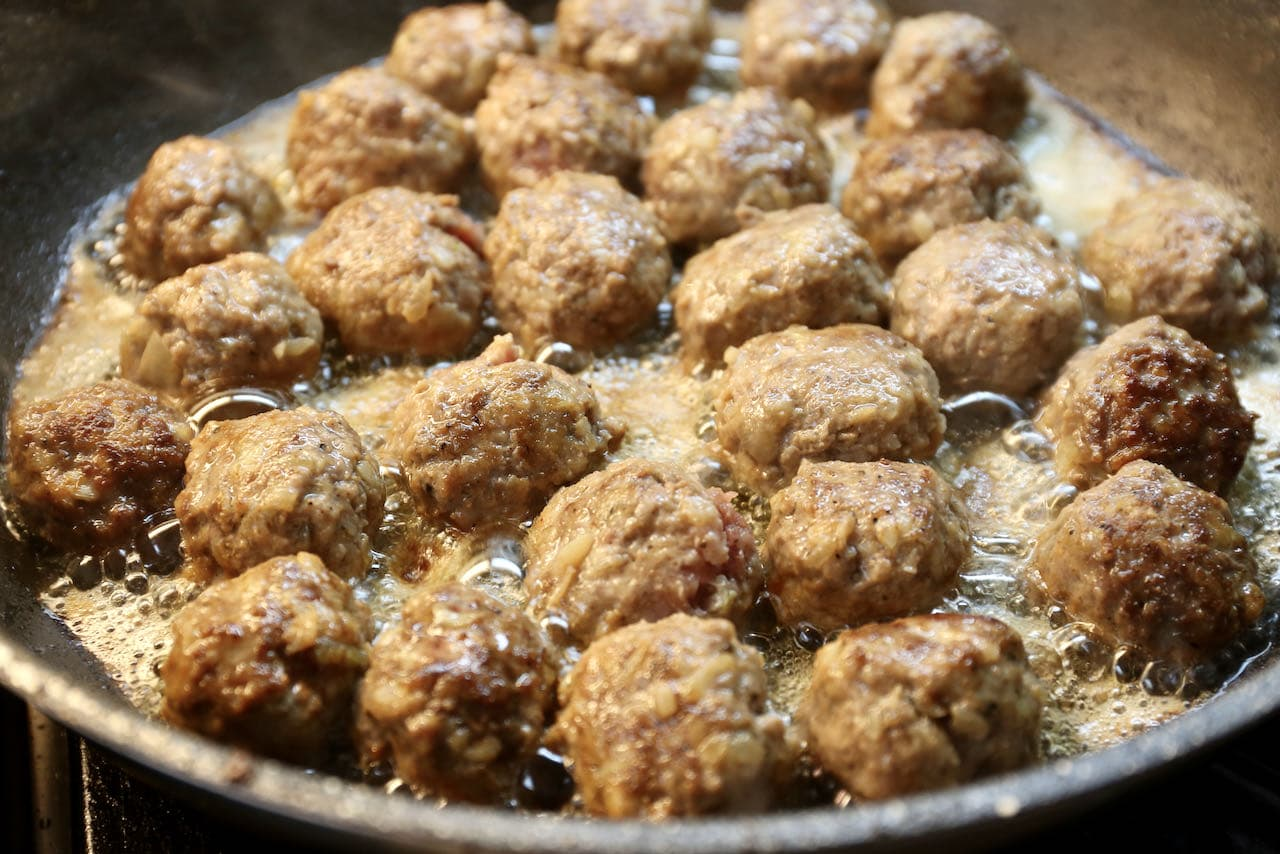 Köttbullar are finished cooking once they have browned and have a crispy exterior.